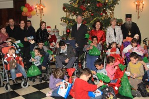 HRH Crown Prince Alexander II, HRH Crown Princess Katherine, Mrs Kathy Fanslow, President of Lifeline Chicago Humanitarian organization and His Grace Bishop Jovan of Lipljan with children during Christmas receptions at the White Palace