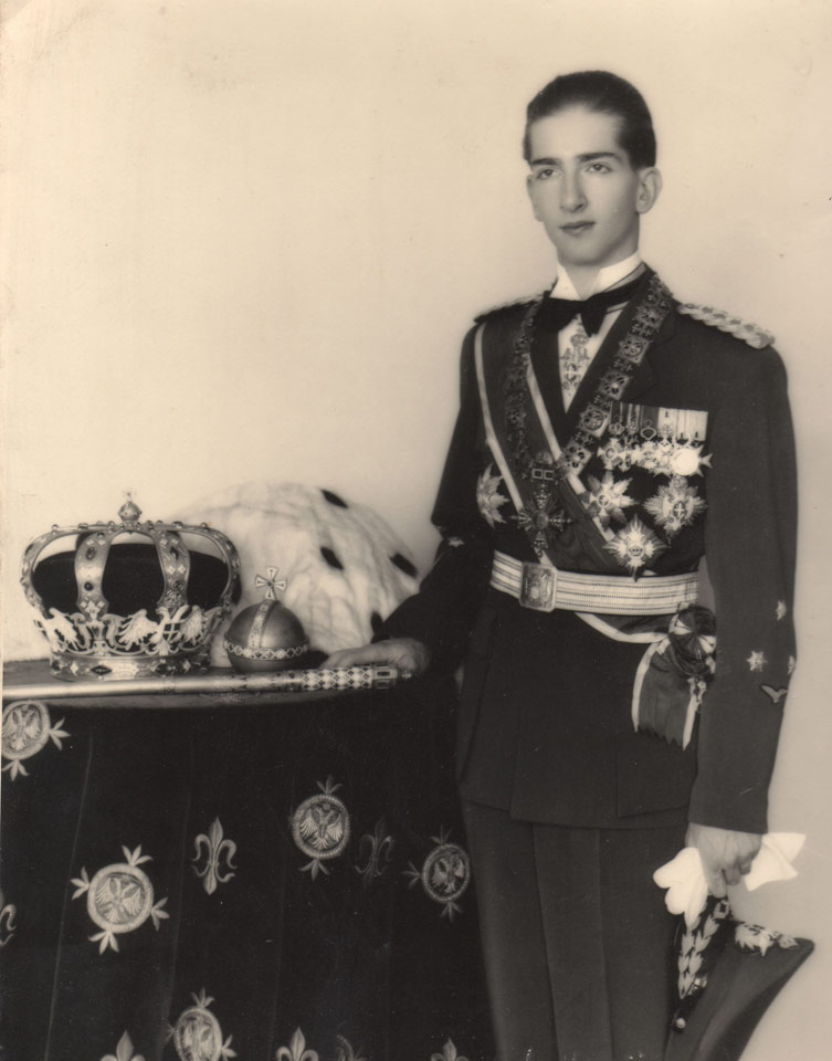 King Peter II wearing a General's uniform, with the Regalia