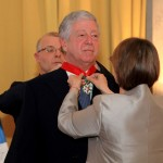 HE Mrs. Christine Moro, Ambassador of the Republic of France handing the decoration to HRH Crown Prince Alexander