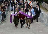HRH Hereditary Prince Peter carrying a wreath, behind him HRH Crown Prince Alexander and HRH Crown Princess Katherine