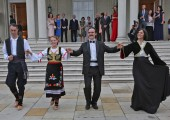 Newlyweds dance kolo in front of the White Palace