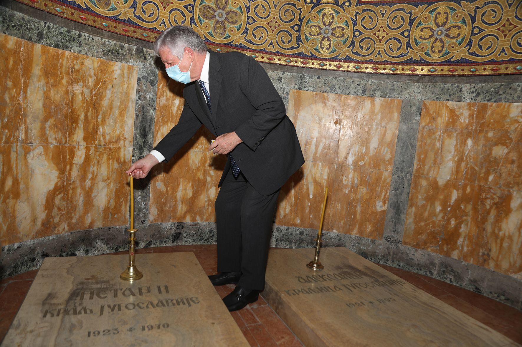 HRH Crown Prince Alexander lighting a candle on the grave of his father, HM King Peter II