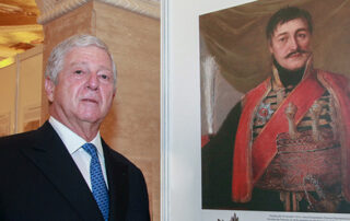 Crown Prince Alexander next to a portrait of Karadjordje