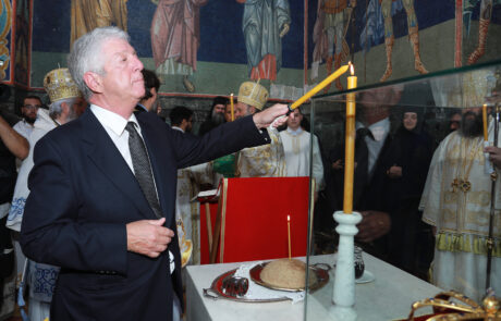 HRH Crown Prince Alexander lights a candle in honor of his great - grandfather King Peter I